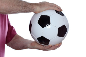holding a soccer ball in hands