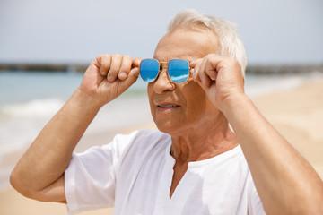 Happy senior man walking on the beach