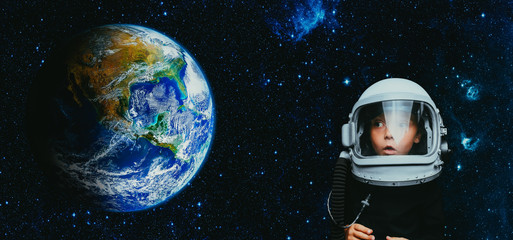 Wall Murals Nasa Small child wants to fly an airplane wearing an airplane helmet
