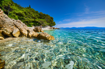 Amazing seascape of Adriatic sea. Luchica beach Croatia, Europe. Colorful summer view of small beach. Croatian coast with clear water and pine trees around. Tropical viewpoint for design postcard.