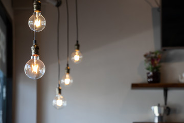 vintage light bulb hanging from ceiling for decoration in living room. Fototapete