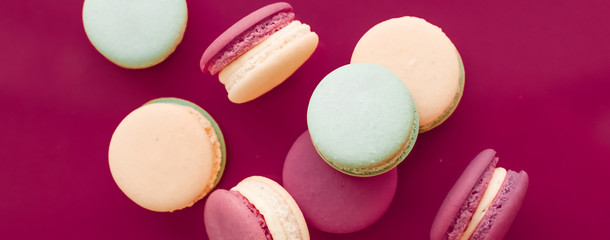 French macaroons on cherry pink background, parisian chic cafe dessert, sweet food and cake macaron for luxury confectionery brand, holiday backdrop design Fototapete