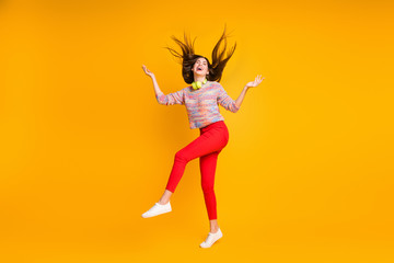 Full size photo of cheerful excited wild girl hold hand enjoy raindrops flying haircut look up...