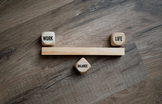 Cubes and dice with work life balance on wooden background