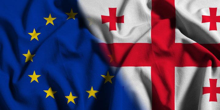 National flag of Georgia with European Union (EU) flag on a waving cotton texture background