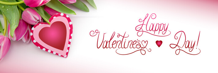 Vlentine's Day heart and a bouquet of beautiful tulips on wooden background.