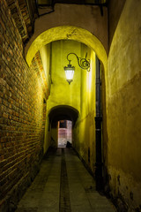 Foto op Plexiglas Smal steegje Narrow Alley in Old Town of Warsaw by Night