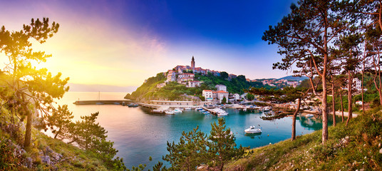 Town of Vrbnik (Verbnik) harbor view morning glow, Island of Krk, Kvarner bay archipelago, Croatia, Europe. Dramatic summer seascape of Adriatic sea. Stone beach. Incredible morning cityscape.