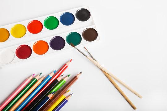 Watercolor paints and color pencils