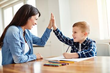homework teaching boy high five education mother children son familiy childhood