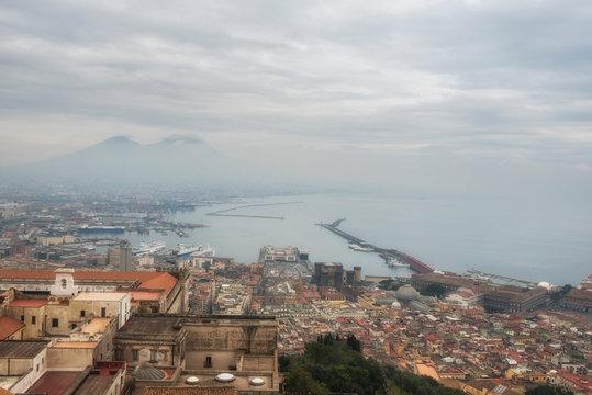 Aerial view of Naples city centre and volcano Vesuvius, Naples port (Napoli bay), Italy