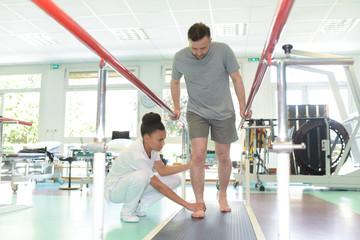 a man in walking rehabilitation