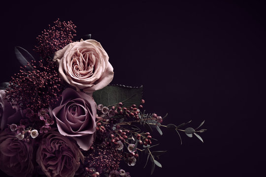 Beautiful bouquet on black background, space for text. Floral card design with dark vintage effect