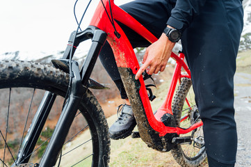 Man connecting an electric mountain bike