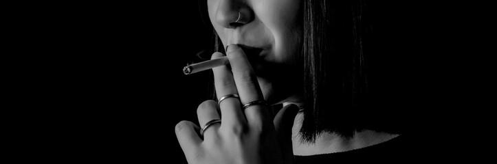 smoker woman close-up photo black and white