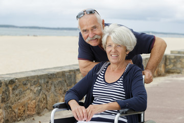 portrait of senior couple woman in wheelchair Wall mural