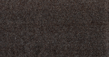 Brown cashmere fabric striped zigzag. Herringbone tweed, Wool Background Texture. Coat close-up. Expensive men's suit fabric. High resolution