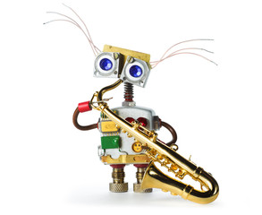 Funny robot toy with saxophone in his hands. The robot plays the saxophone.