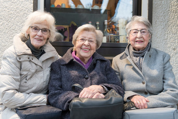 Three Senior Ladies Sittung on a Bench