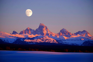 Sunset Light Alpen Glow on Tetons Teton Mountains wtih Moon Rising