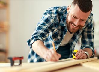 Fototapeta young male carpenter working in  workshop. obraz