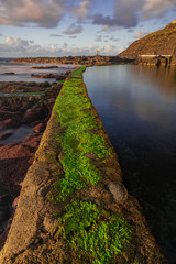El Pris pool wall with green moss, close to Atlantic ocean with volcanic rocks, long exposure photography, Tacoronte, Tenerife, Canary islands, Spain