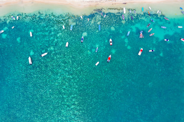 Aerial by drone of boats in the turquoise water of lagoon front of Mont Choisy beach, north-west coast, Mauritius, Indian Ocean, Africa