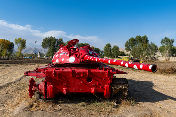 Old soviet tank painted in funky colours, Bamyan, Afghanistan, Asia