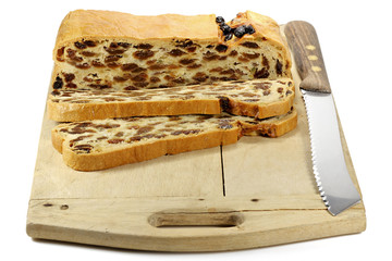 Bremer Klaben, a type of Stollen from Bremen, Germany, on a vintage wooden cutting board isolated on white background