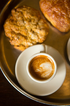 Espresso beverage with fresh pastries