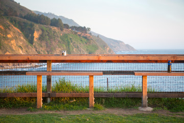 Cute bench with a view of the Pacific ocean and beautiful coastline of California in Big Sur.