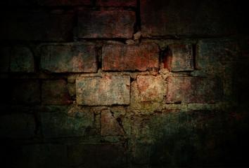 Old vintage brick wall background in dark atmosphere