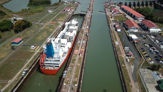 Aerial view of Panama channel - Miraflores locks - ship crossing the Panama Canal