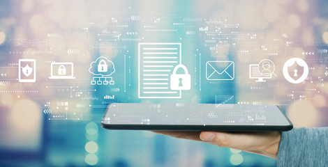 Data protection concept with man holding a tablet computer