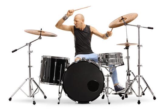 Bald man musician playing drums