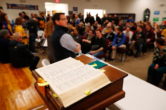 Bible lies open on the altar as the caucus begins at Maple Grove Methodist Church in West Des Moines, Iowa, U.S.