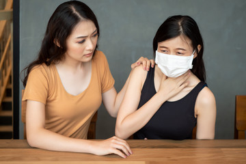 women with face mask from flu infection, sore throat; concept of Wuhan virus, corona virus, H5N1...