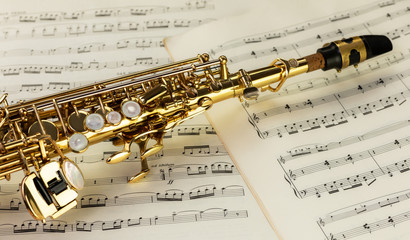 Soprano Saxophone in close-up on musical notes
