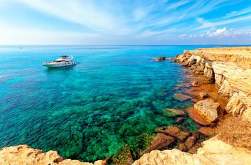 Luxury yacht at sea caves near Cape Greko(Capo Greco) of Ayia Napa and Protaras on Cyprus island, Mediterranean Sea.