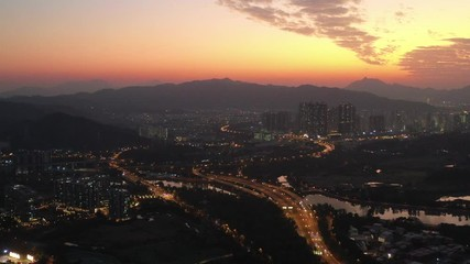 Fotomurales - Aerial View of rural green fields in Hong Kong border and skylines in Shenzhen, China