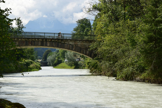 """A view of a bridge crossing the river """" Berchtesgadener Ache"""" whitch nestle up to Salzburger Str. The photo is taken from the point where the river """"Larosbach"""" join together."""