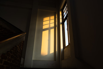 Sunlight from a window in a dark room