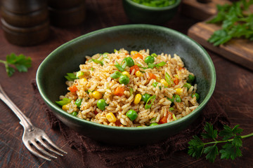 fried rice with vegetables in green bowl