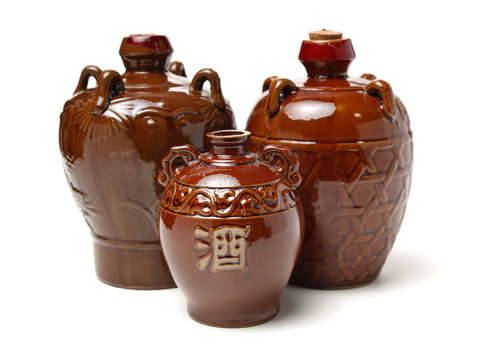 rice wine jar with ceramic bowl on white background