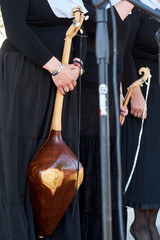 A Georgian woman holds a national musical instrument in her hands