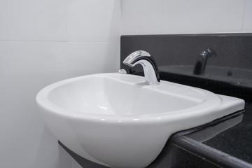 Modern faucet and white ceramic washbasin sink bathroom interior building decoration
