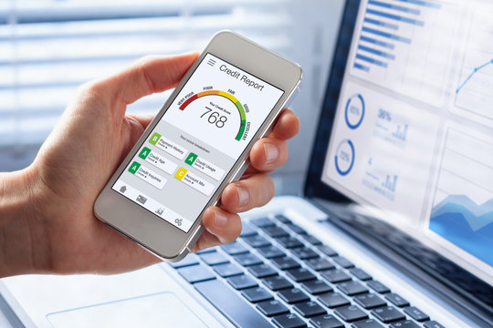 Credit Report with Score rating app on smartphone screen showing creditworthiness of a person for loan and mortgage application based on payment history and debt usage, budget management performance