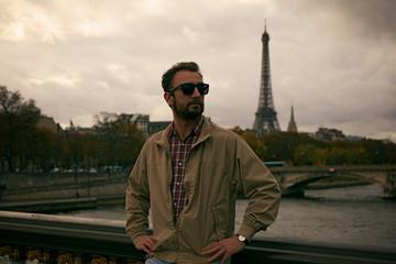Handsome man enjoying in Paris.