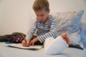 Toddler boy with plaster on his leg