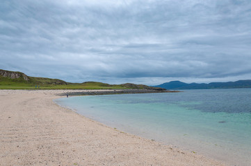 White beach with turquoise sea, Coral Beach, Isle of Skye, Scotland. Concept: famous natural landscape, Scottish landscape, tranquility and serenity, seascape